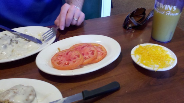 Julwin's sliced tomatoes and cheese grits (grits with cheese on top)