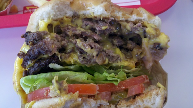 NOM NOM. Bite into the In-n-Ou's 4x4 burger. Greatness