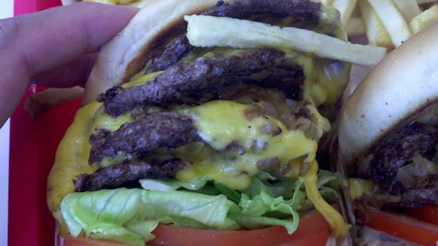 The 4x4 upclose, look at the melted cheese, layers of ingredients, and perfectly charred burgers