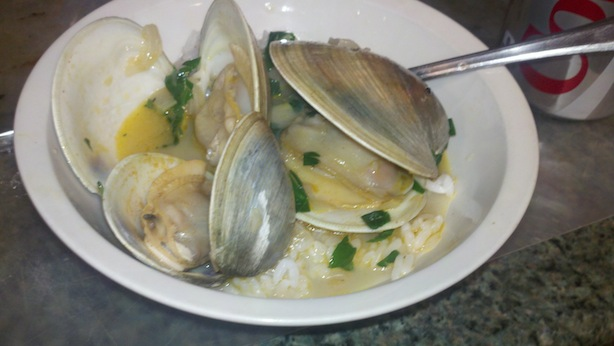 Grilled clams with white wine, butter, pimenton sauce over rice