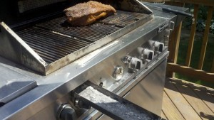 Where to add the wood chips in propane gas grill