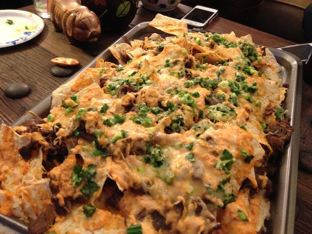 Korean bulgogi bbq nachos with kimchi sour cream