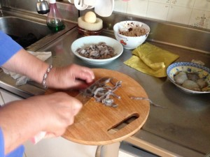 Chopping up the live baby octopus