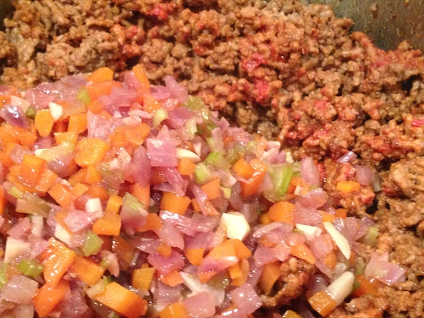Adding the vegetables to the ground beef