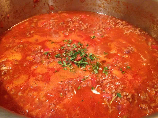 Adding herbs to the bolognese