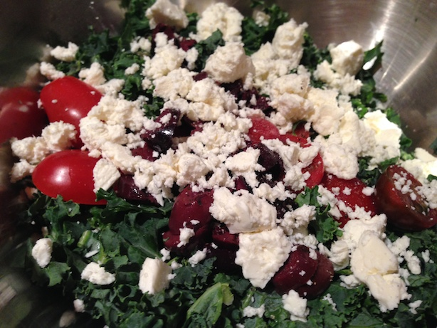 Tossing the kale greek salad