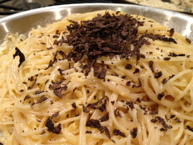 Adding black truffle to the pasta